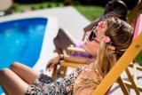 Women relaxing and sunbathing - 220523230