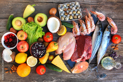 Leinwanddruck Bild Healthy food on old wooden background. Concept of proper nutrition. Top view. Flat lay.