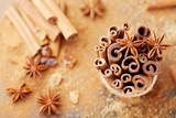 Christmas spices. Anise star, cinnamon sticks and brown sugar. - 220529289