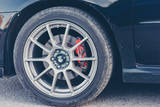 a close-up of the front wheel of the car brakes