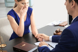 Lawyer having meeting with client in office - 220536659