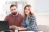 Young couple in office of consulting manager - 220536809
