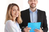 Businessman consulting young woman in office - 220536818