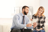 Consulting manager with woman at meeting in office - 220536824