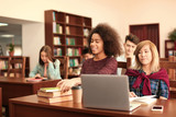 Group of students studying in library - 220537071