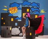 Cute girl as superhero against decoration. Comic strip city theme - 220537083