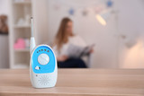 Baby monitor and woman on background. Radio nanny - 220537207