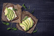 Leinwanddruck Bild - Sandwiches with rye bread and fresh sliced avocado
