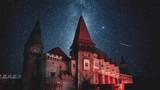 Milky Way timelapse over Corvin Castle Romania night sky shooting stars  - 220545850