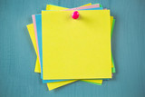 Multicolored sticky empty notes on the bulletin board.  - 220547643