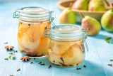 Ingredients for fresh pickled pears in the jar - 220553084