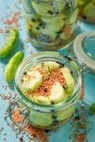 Homemade and tasty canned cucumber on blue table - 220553204