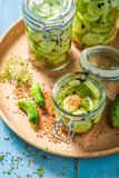 Natural and healthy canned cucumber in the jar - 220553228