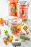 Preparation for fresh canned red tomatoes in the jar - 220553255