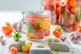 Natural and healthy canned red tomatoes in summer - 220553258
