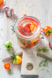 Fresh ingredients for pickled red tomatoes in the jar - 220553273