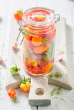 Homemade and tasty canned red tomatoes in the jar - 220553295