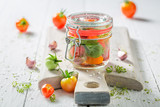 Homemade and tasty pickled red tomatoes in summer - 220553296
