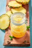 Homemade canned pineapple with sugar and mint leaf - 220553606