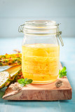 Sweet canned pineapple with sugar and mint leaf - 220553619