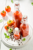 Red and spicy passata prepared from tomatoes - 220553626