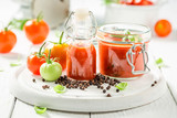 Red and spicy ketchup made of tomatoes - 220553655