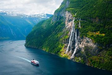 Breathtaking view of Sunnylvsfjorden fjord and famous Seven Sisters waterfalls, near Geiranger village in western Norway. © ivan kmit