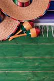 Mexico sombrero border mexican maracas old green wood background vertical - 220592607