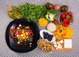 Image of ready-made salad and its ingredients - 220611641