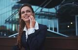 business woman talking on smartphone in a street