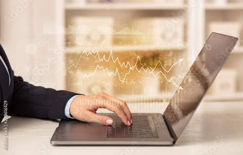Business woman in homey environment using laptop with global financial report concept © ra2 studio
