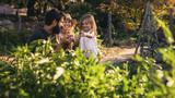 Family having fun in their farm - 220618895