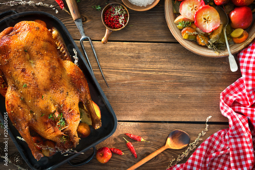 Roast Christmas duck with thyme and apples - 220630455