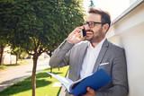 Businessman using mobile - 220643622