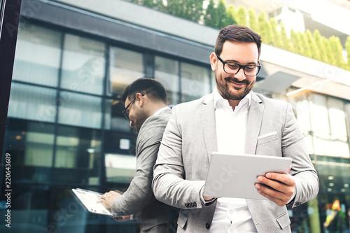 Businessman using tablet © grki