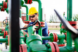 Engineer, working with pipeline controls inside oil and gas refinery - 220652267