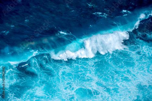 Foto Murales Pattern of Ariel view waves. The viewpoints at Kelingking Secret Point Beach, Nusa Penida