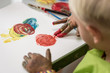 Little boy having fun painting with fingers