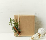 Christmas present decorated with natural evergreen twigs. Copy space - 220670863