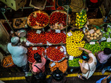 people buying food, fruit and vegetables at a stall in traditional central market in Port Louis, Mauritius - 220673048