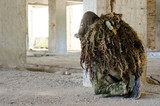 Sniper kneeling supported firing position ghillie suit ,inside building take cover  - 220676884
