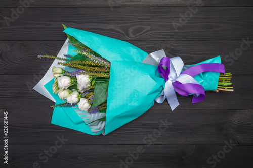 White roses on rustic wood background