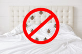 Stop sign with insects against bed background. There should be any bugs in bedroom. Hotel room being testified on cleanliness and purity - 220686463