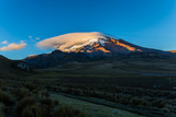 Chimborazo with clouds and blue sky - 220690072
