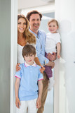 Happy family in doorway - 220691893