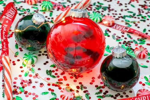 decoration with red fluid filled christmas ornament ball and two green filled ornament balls surrounded by