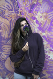 pensive girl with a flower - 220700644