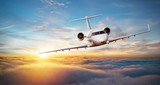 Luxury private jetliner flying above clouds - 220703053
