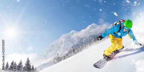 Leinwanddruck Bild Man snowboarder riding on slope.