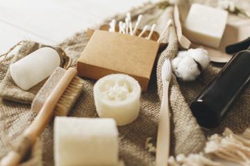 natural eco bamboo toothbrush, coconut soap, handmade shampoo, crystal deodorant, luffa, bamboo ear sticks, brush. zero waste concept, sustainable lifestyle. plastic free © sonyachny